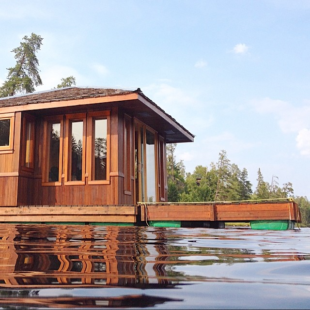 House on a lake in the woods.