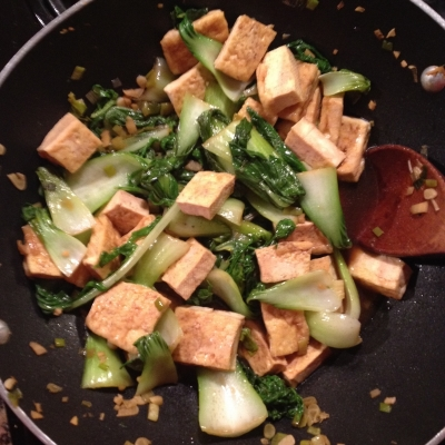 Tofu, mizuna, and baby bok choy in a stir fry.