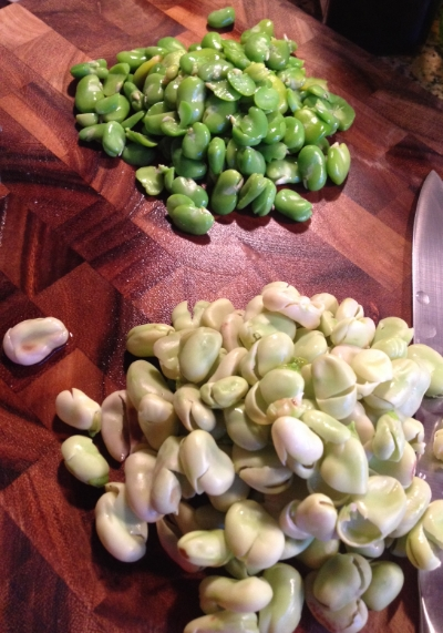 Bright green fava beans after being removed from their tough outer skins.
