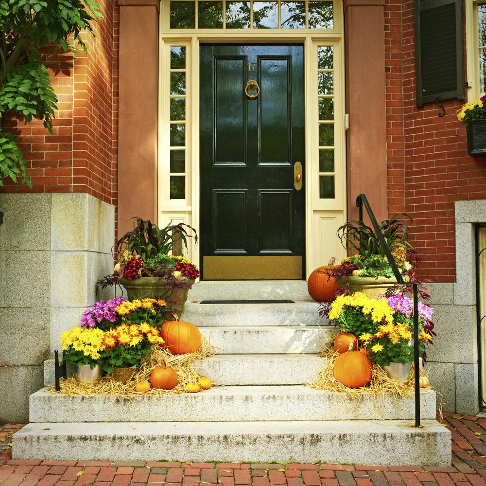 fall doorstep with pumpkins energia llc