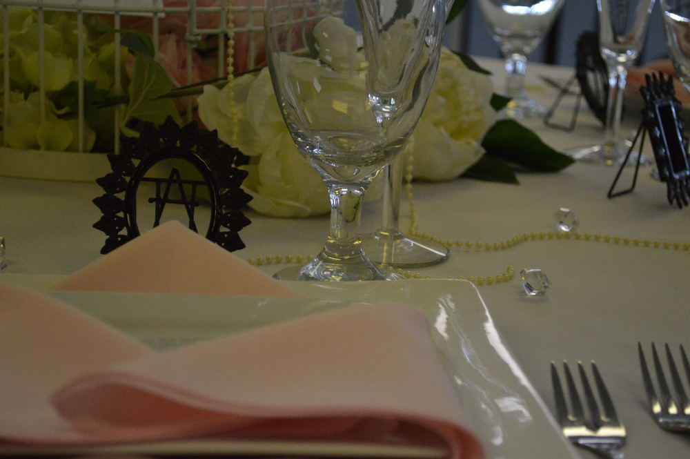 Displayed: Square China, Light Pink Napkin, White Linen Flatware