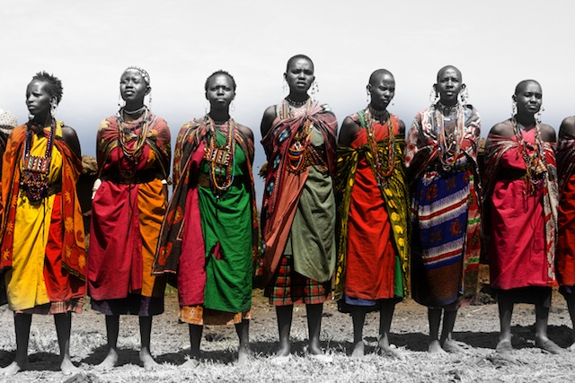 East African women wearing the traditional kanga, a fabric wrap that often has thoughts or sentiments printed on the fabric. Wearing kangas with printed thoughts allows women to subvert cultural dicta preventing them from speaking frankly. Thank you, Ziddi Msangi, for your amazing work on the topic.