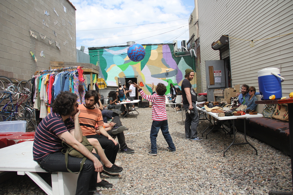 Natives and newcomers chill at the Silent Barn Yard Party. Photo credit Andrew McFarland.
