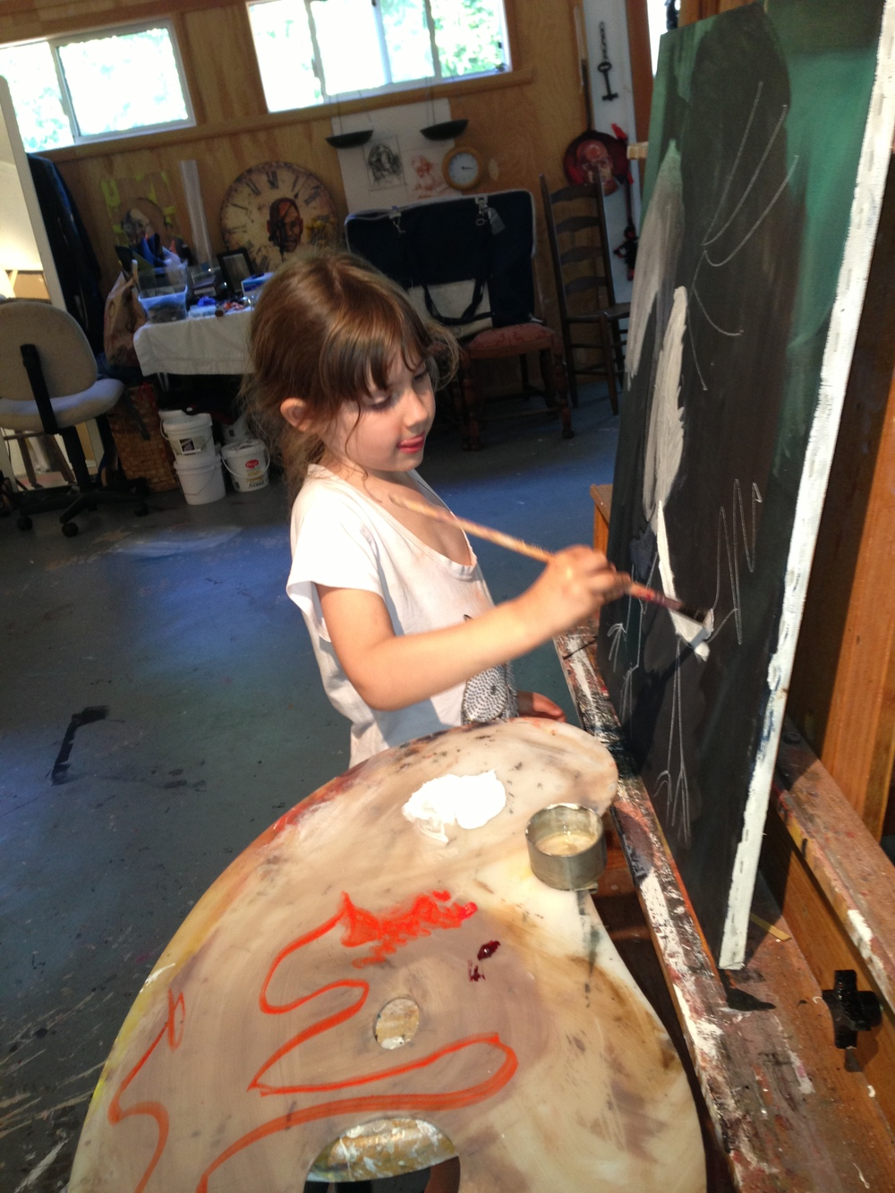 Nikka (5 years old), working with oil paints in Y.A.P. studio