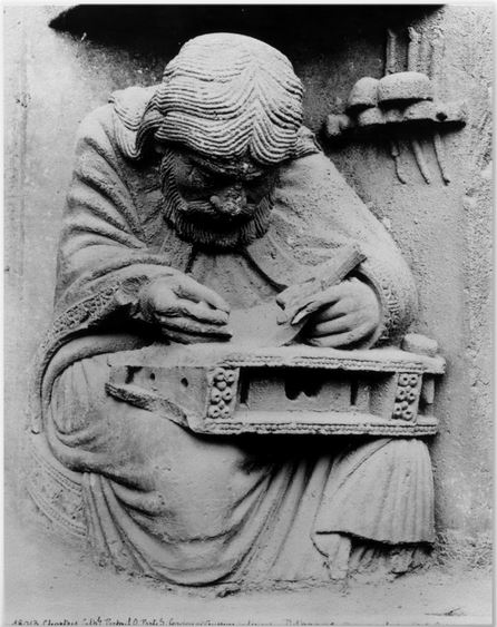 The figure of Pythagoras studying the divine laws of harmony, Chartres Cathedral, Royal Portal, west façade, right doorway tympanum, under the figure of the Virgin inside a Vesica Piscis.