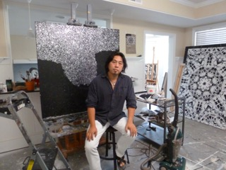 Chinese contemporary painter Caomin Xie pictured in his Atlanta, GA studio with works in progress, July 2015