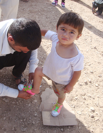 Buckner International and Texas Baptist Men worked through a Christian humanitarian aid worker serving in northern Iraq to send clothing, diapers and medical equipment, along with more than 6,700 pairs of shoes