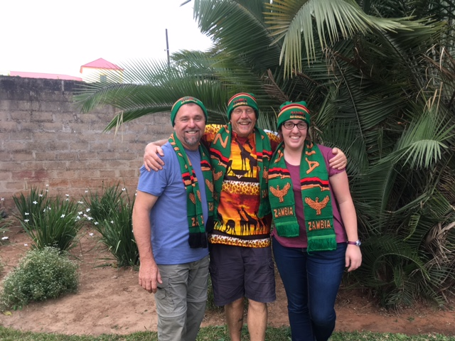 The 3rd is of our leaders modeling the beautiful Zambia hats and scarves we were gifted with upon arrival.