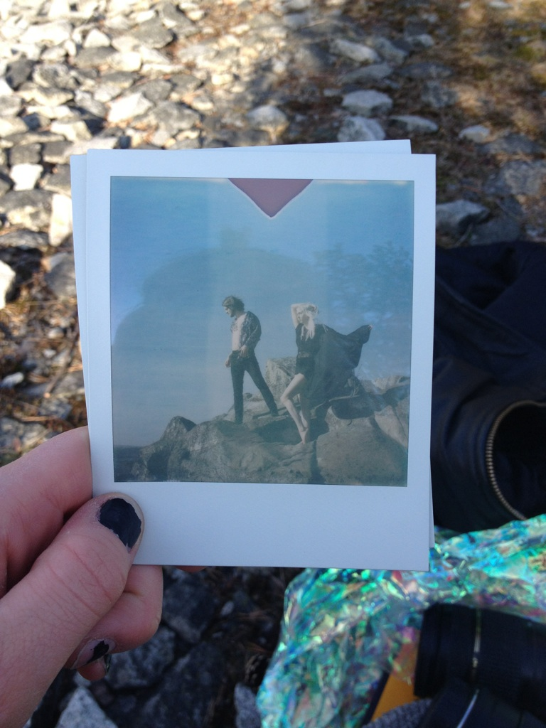 For about 2 years ago we went on a hike with the fantastic photographer  Olof Grind Photography  We went to a rocky place. There was a small lake surrounded by mountains. Olof took this amazing photo with his Polaroid camera. We could watch this picture slowly reveal itself after coming out of the camera. It almost looked like a painting. There it was, our album cover. We both felt it. Pure magic! So this is the story behind this photo. It is actually real and raw material without any post editing.  Olof Grind deserves a golden star! ⭐️ Thank you for this beautiful picture! ♥