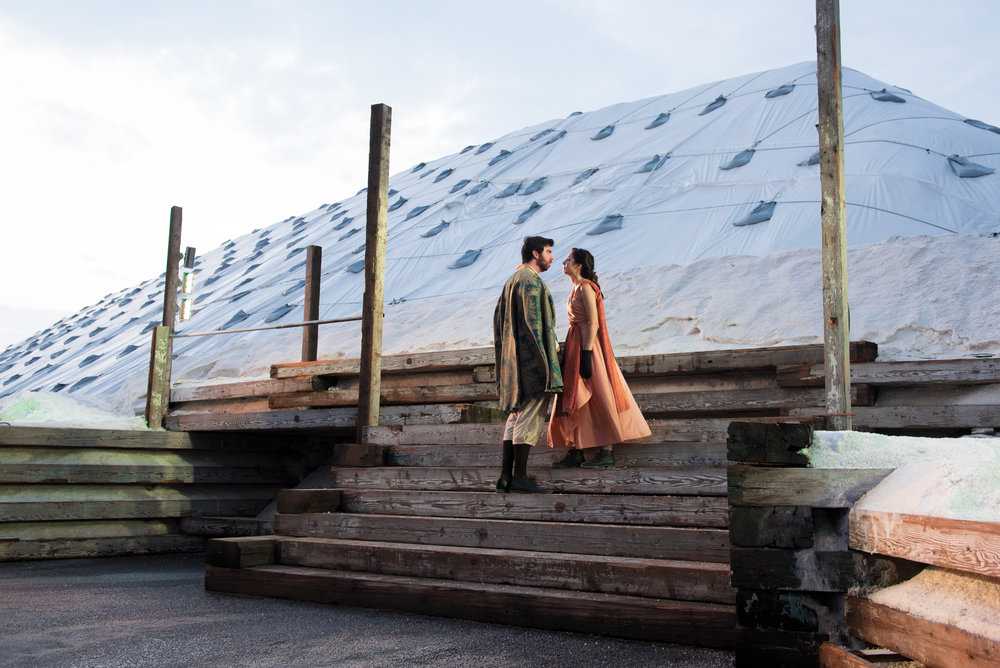 Actor John Manning as Demetrius and actress Kelly Young as Helena shared an intense moment against the luminous salt pile backdrop. The salt white mounds offer a unique landscape for the Apollinaire Theatre to allow its creativity to shine through on.