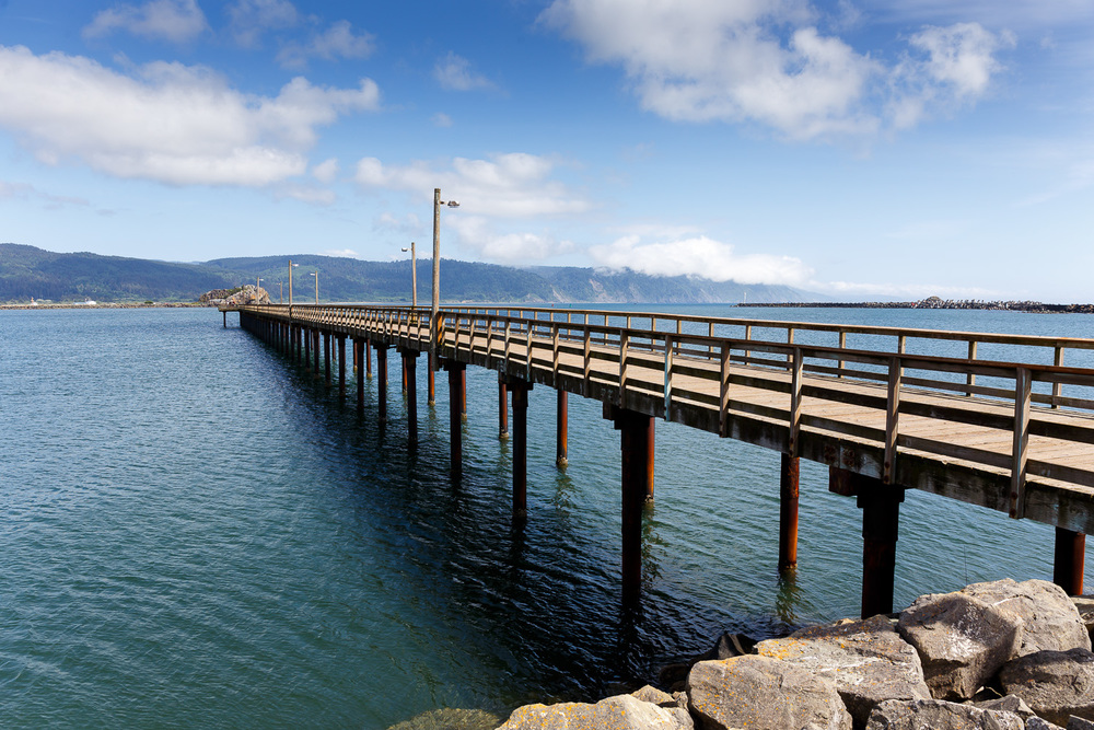 A long pier sticking out into Crescent Harbour, Crescent City, CA.
