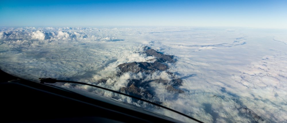 Mountains poking through the clouds as we make our way up the East Coast of the South Island.