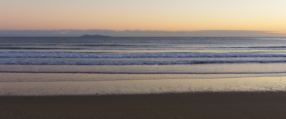 A peaceful ocean at sunrise, Mount Maunganui.
