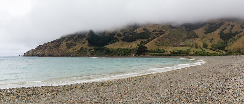 Hills at Cable Bay showing themselves from underneath the cloud.