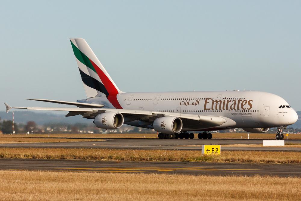 A6-EDA departing runway 23L at Auckland.