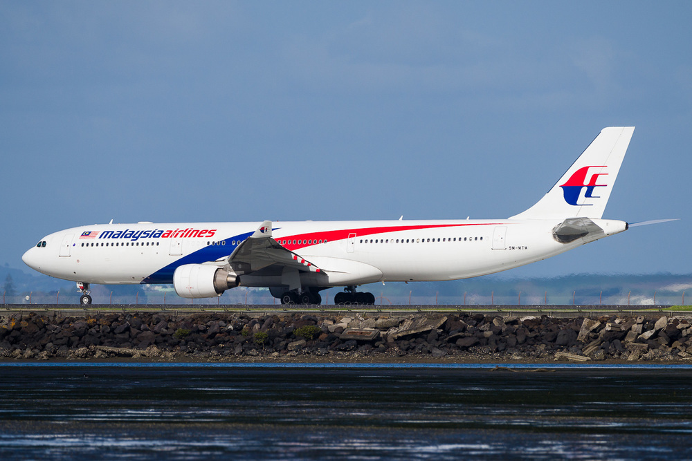 Malaysia Airlines A330-300 9M-MTM departing runway 05R.