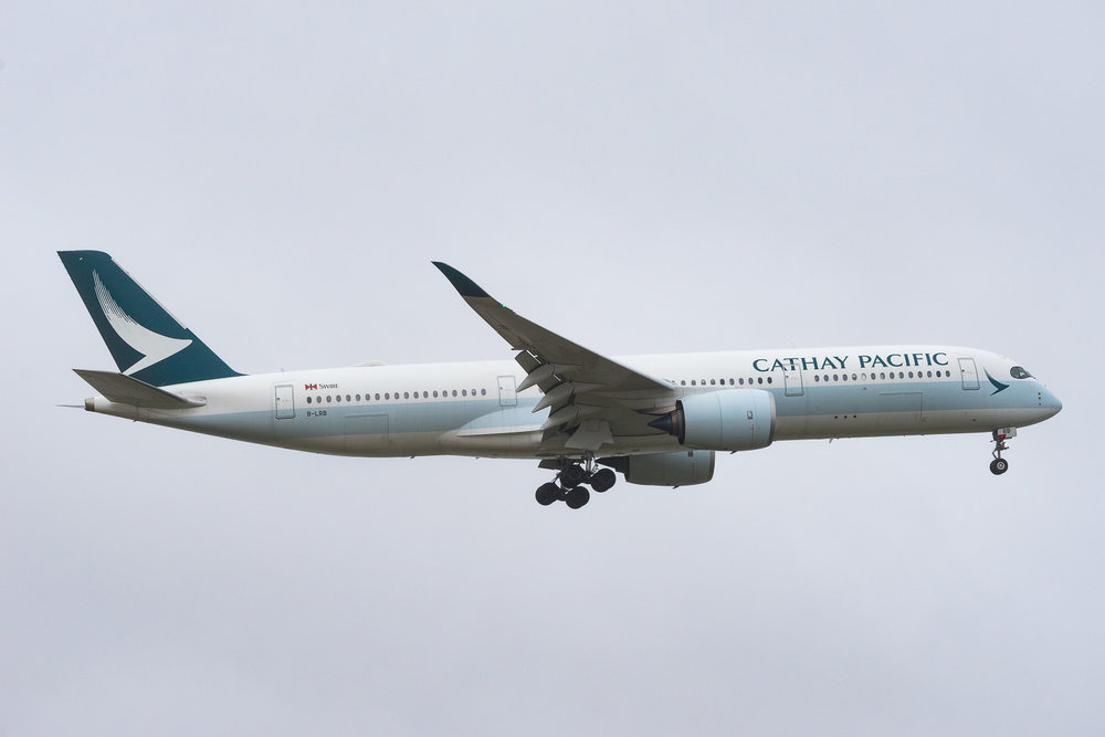 Cathay Pacific Airbus A350-900 B-LRB arriving in Auckland during wet northerly weather. CX117 from Hong Kong. January 2017
