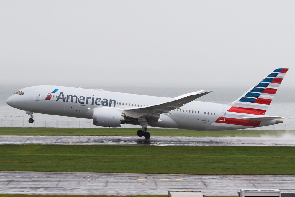 American Airlines Boeing 787-8 N814AA departing runway 05R on a miserable winter afternoon at Auckland. This is the inaugural service to Los Angeles. June 2016