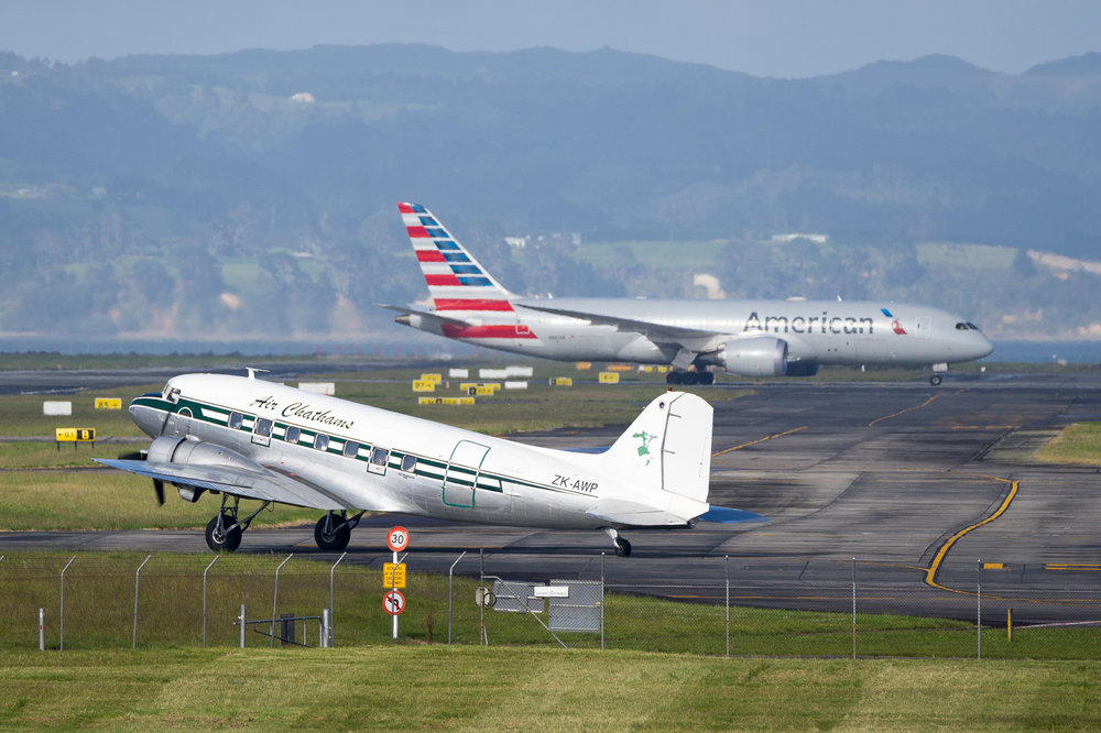 Air Chathams DC-3 ZK-AWP in Auckland. American Airlines Boeing 787-8 N802AN in the distance. November 2016