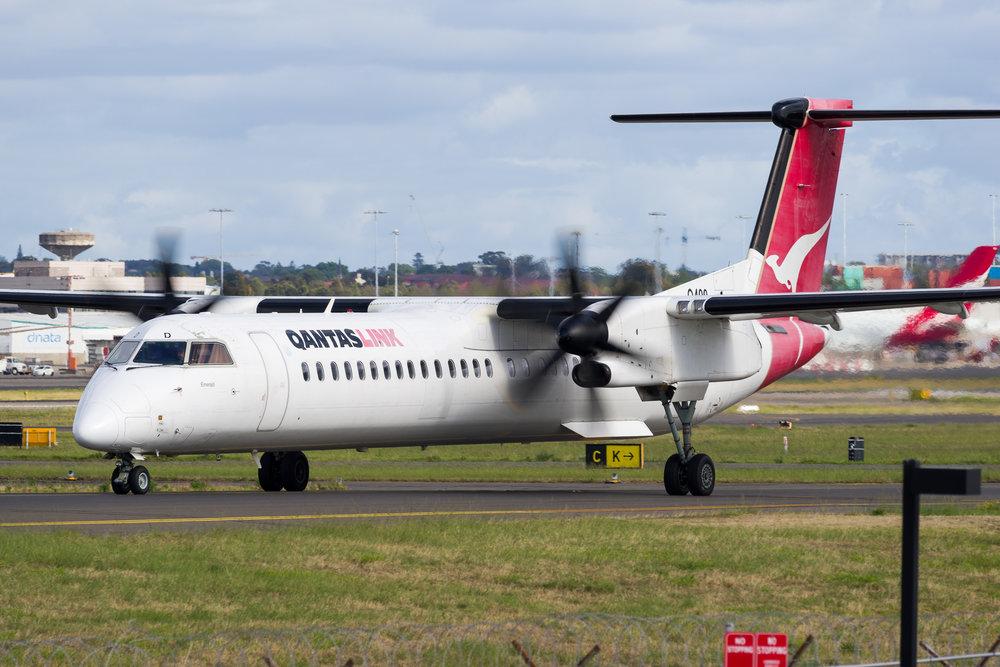 QantasLink Bombardier Dash8 Q400 VH-LQD departing Sydney. 12/11/2017