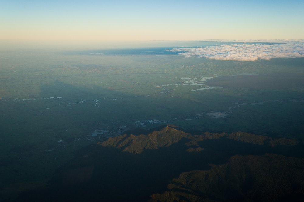 Overflying a flooded looking Te Aroha. Mount Te Aroha in the foreground, casting its shadow over the township.