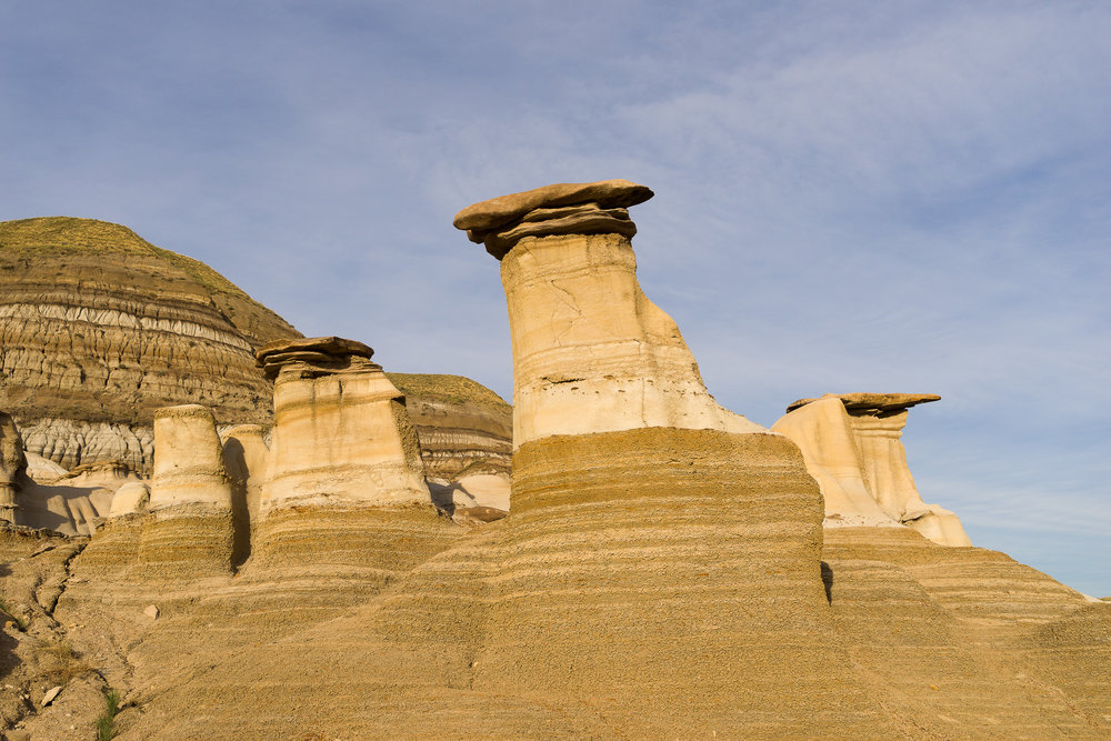 Hoodoos, showing what remains of the rock after centuries of erosion. Badlands, near Drumheller, AB, Canada.