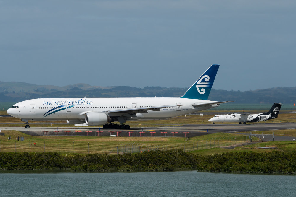 Air New Zealand Boeing 777-200ER ZK-OKD with Air Nelson Bombardier Q300 ZK-NEA, waiting to depart Auckland. 19/12/2017