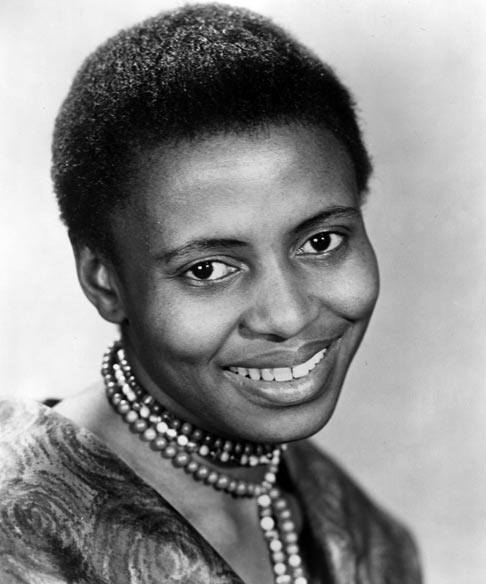 "This is Zenzile Miriam Makeba of South Africa. She was a singer and activist who was known as ""Mama Africa"" as she was the first to truely send African Music around the globe in the 1960's. While touring around the world she spoke against Apartheid and her contributions in film and music won her a grammy and a critics award at the Venice Film Festival (well the film she featured in anyways). South Africa didn't appreciate this and revoked her citizenship and banned her from entering her country... What's dope about her? She insited on touring with no make up and or alterations to her hair (#donttouchmyhair), she performed at the rumble in the Jungle, stole the show at JFK's birthday without jumping out of a cake (but then had her visa and record contract revoked after marrying Stokley Carmichael!), she spoke at the UN General Assembly and also won the Dag Hammarskjöld Peace prize."