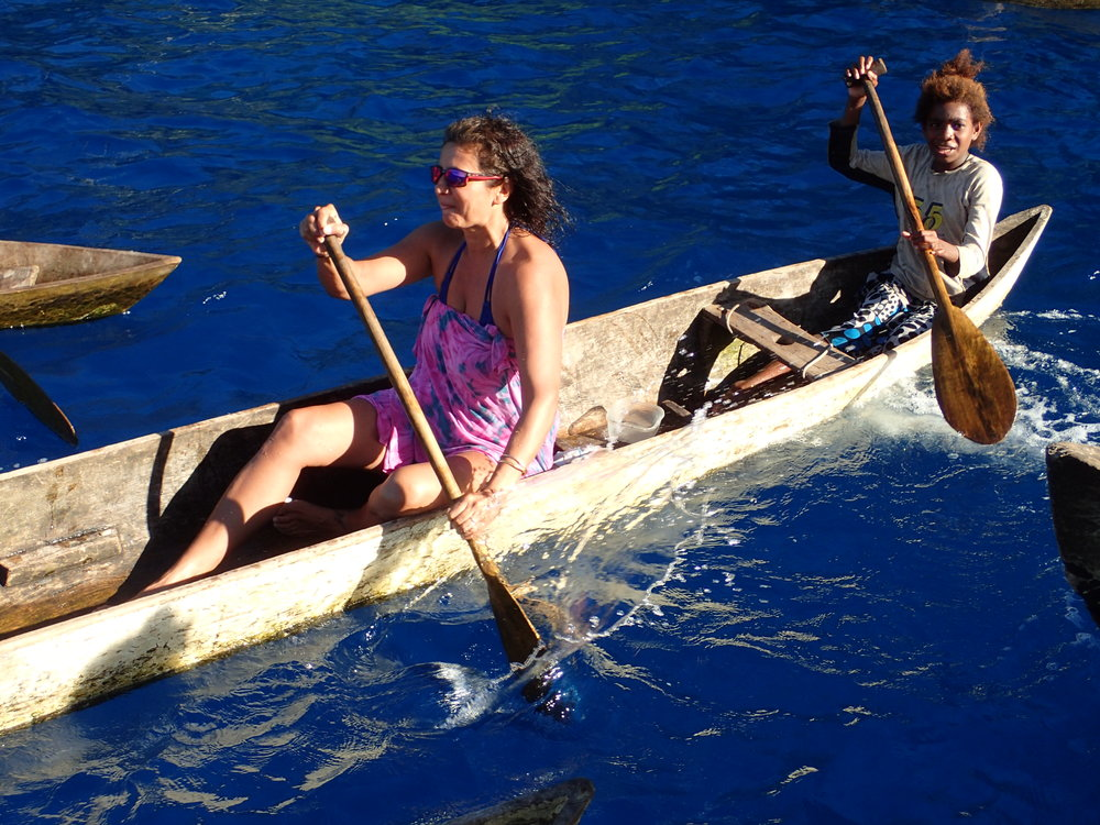 Our guests join a local villager on a canoe ride around Taka.  It is trickier than it looks!