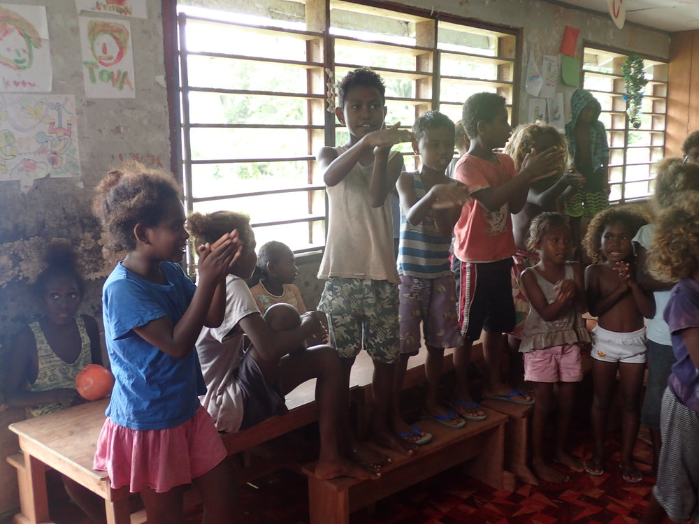 Local Solomon Islands children sing a song for our guests on board Taka!