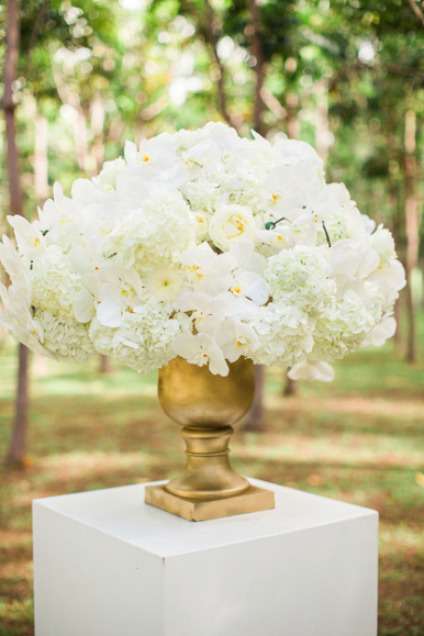 Arrangements of White Hydrangeas, Roses, and Orchids with Gold Accents Make Romantic Ceremony Decor