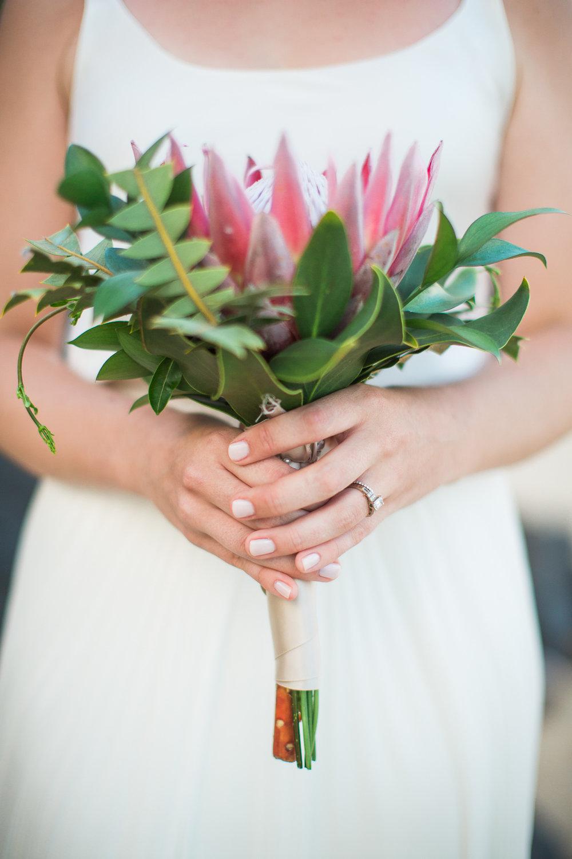 A Unique King Protea Bouquet for this Bride