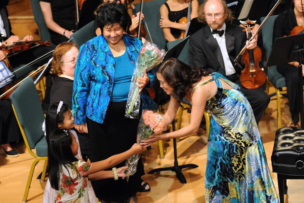 Ms. Long receiving flowers