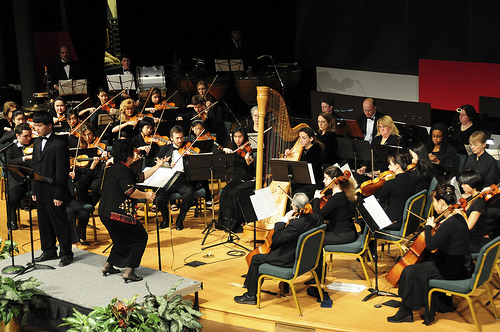 "Orchestra performing Britten's ""Young Person's Guide to Orchestra"""