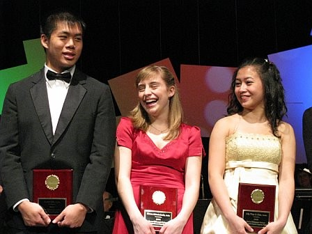 Three happy soloists receiving their awards