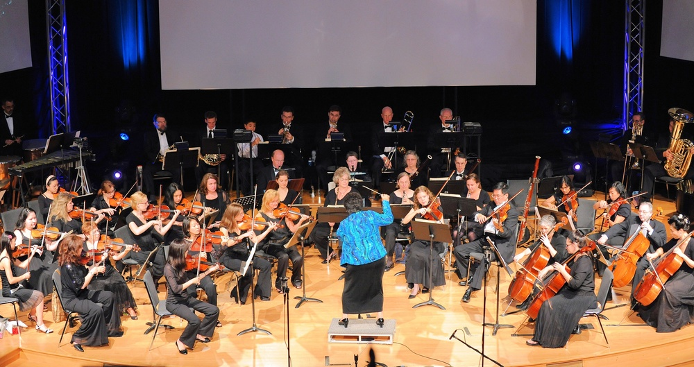 Orchestra in intense performance of Dukas Sorcerer's Apprentice