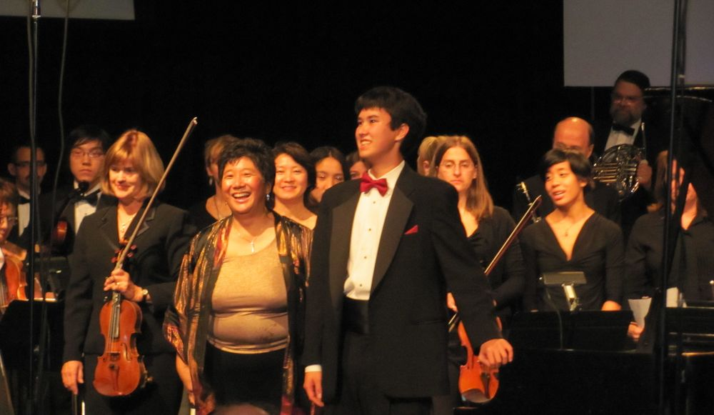 Paul von Autenried, Jr. and Maestra Lin in curtain call