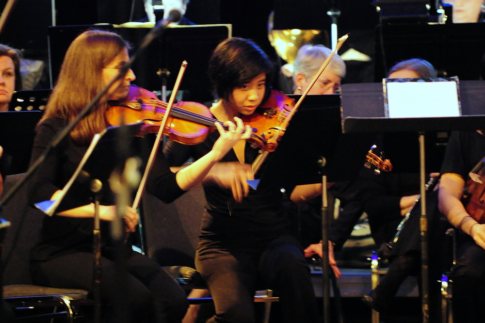 2nd violin principal Francine Bloom with assistant Constance Kaita in performance