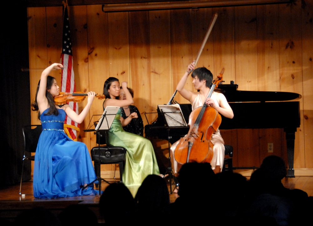 NaYoung Yang, Constance Kaita, and Courtney Kaita strike the final chord of Mendelssohn's C minor Trio