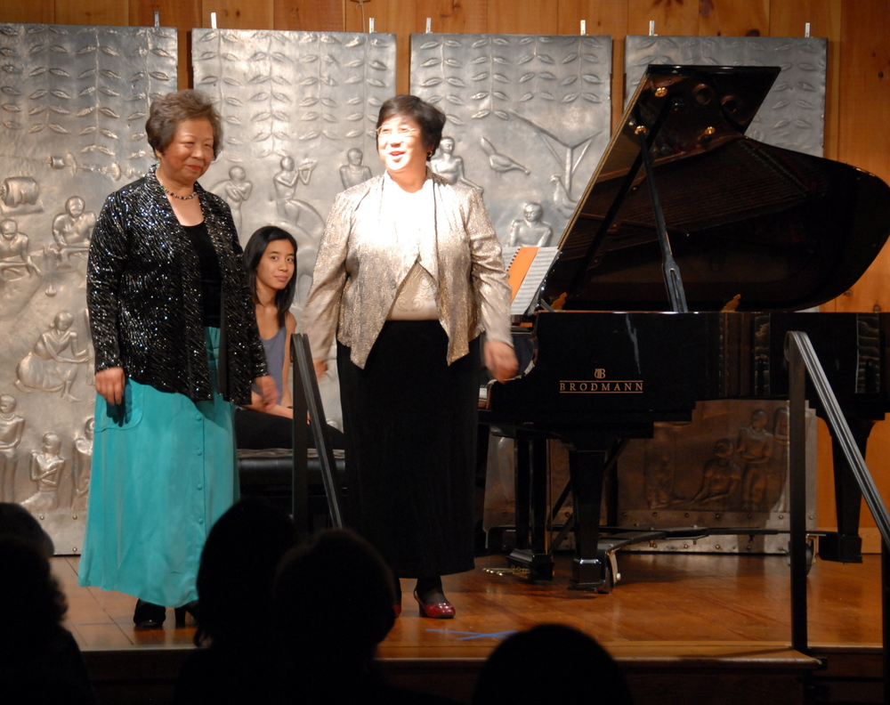 The Lin sisters in a piano duet by Paul Schoenfield