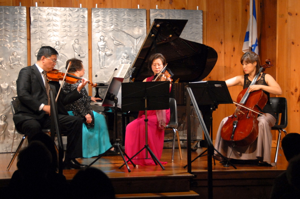 Violinists Ning Mu and Ingrid Tang, pianist Chiu-Ling Lin, and cellist Mira Kang performing a rarely heard but magnificent piano quartet by Korngold