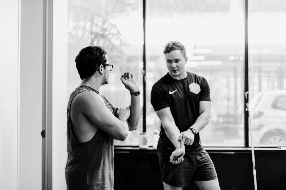 Tom Fitzgerald training a client.JPG