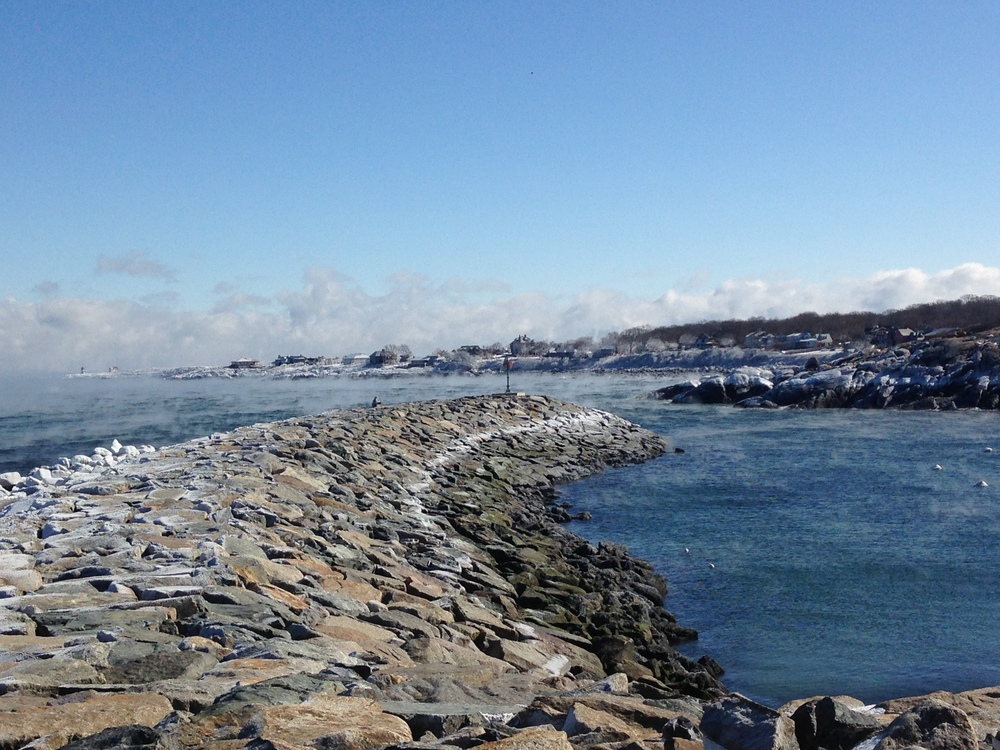 An amazing display of nature's raw power in Rockport Harbor, Mass. With the wind chill, it was -19 degrees. What looks like steam in this photo is actually the sea mist turning to ice in the air. All of the white along the rocks is actually ice. On the far tip, you can barely make out a light house that was covered in ice. Absolutely beautiful!