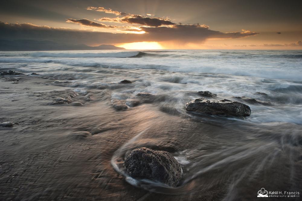 Stalking rocks on the beach at sunrise