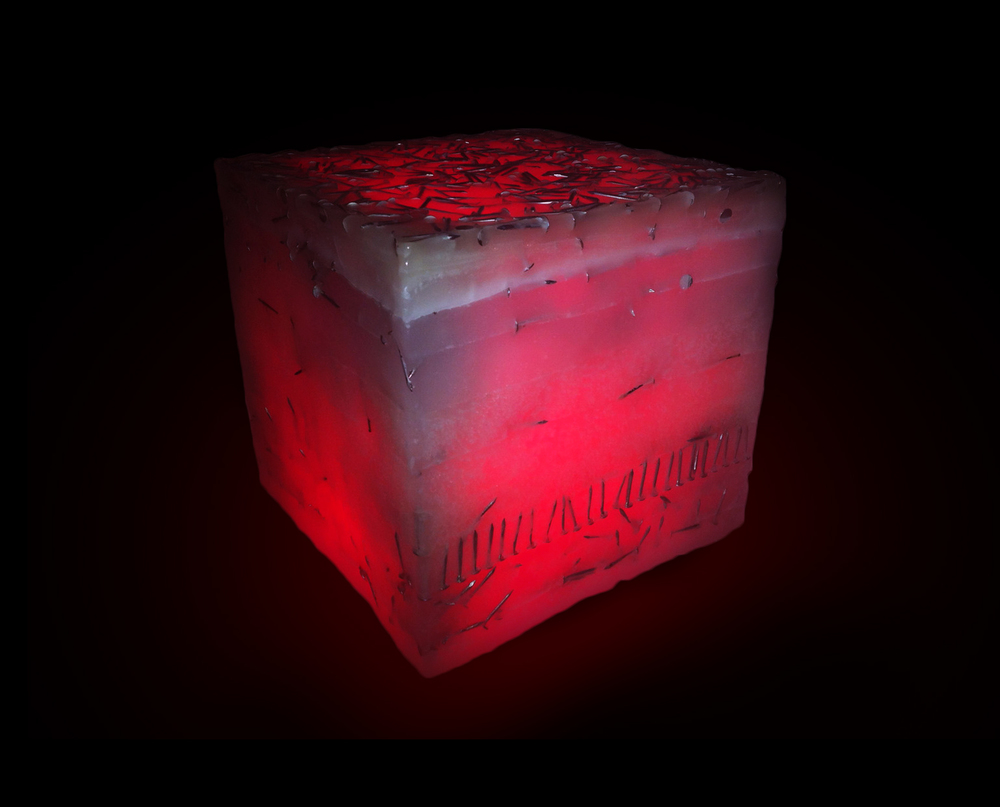 1x1x1 square foot cube made of wax and nails illuminated by red LED.