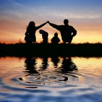 Family and water pool at sunset