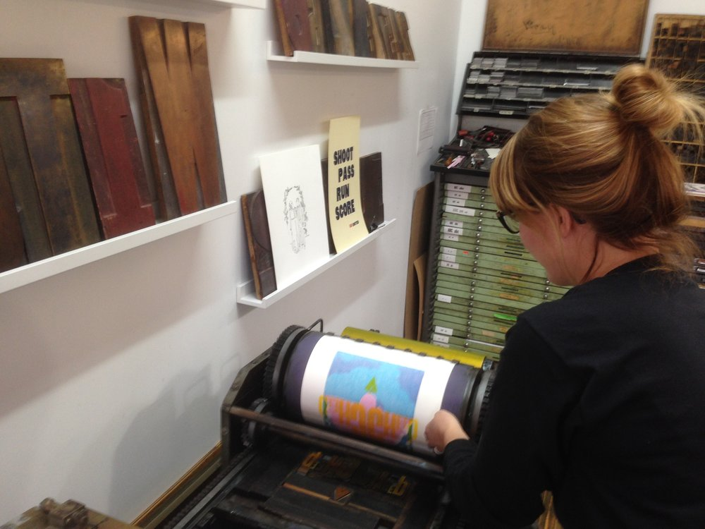 heather with poster on press.JPG