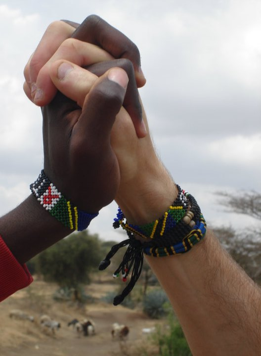"This photo of Uswege and I bringing our hands together was taken near our village. This symbol of ""togetherness"" translated into the purpose and vision of RENEW, and eventually became the logo."