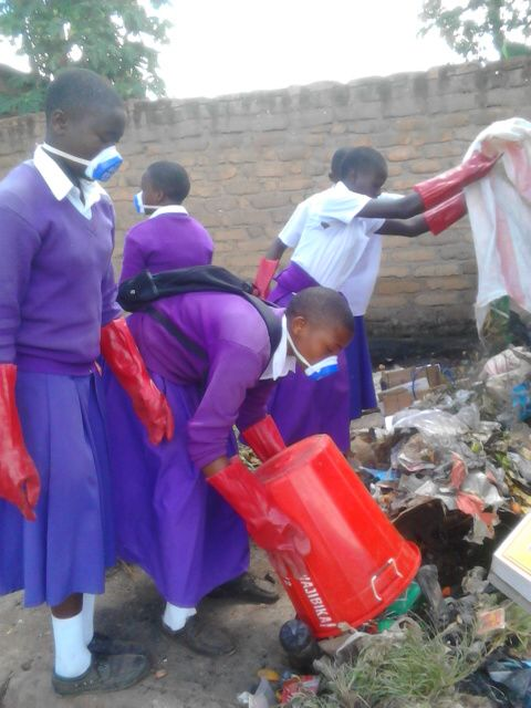 Students collecting trash and refuse at the local marketplace
