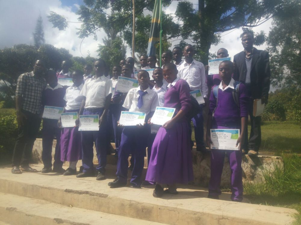 Students proudly show their GYSD certificates after the project